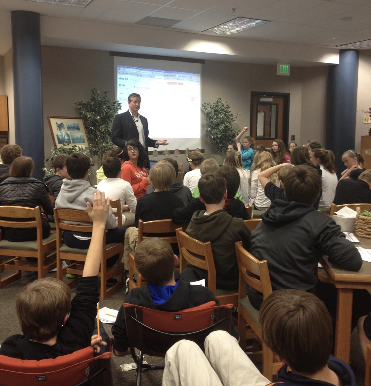 Tyler Tysdal teaching class of young entrepreneurs